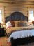 Wood bed in log home, big sky mt