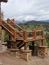 Custom Rock Work on Big Sky Log Home Siding and Pillars to Stairs