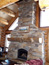 Rock fireplace handcrafted with log mantle, bozeman, mt