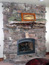 Rock Fireplace handcrafted with log mantle, big sky mt